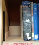 "Reference books at Pendlebury Library of Music, with gap where books have been ""liberated"" (i.e. made ordinary loan books)"